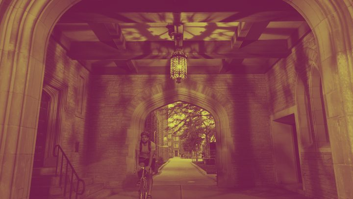 A cyclist underneath an archway